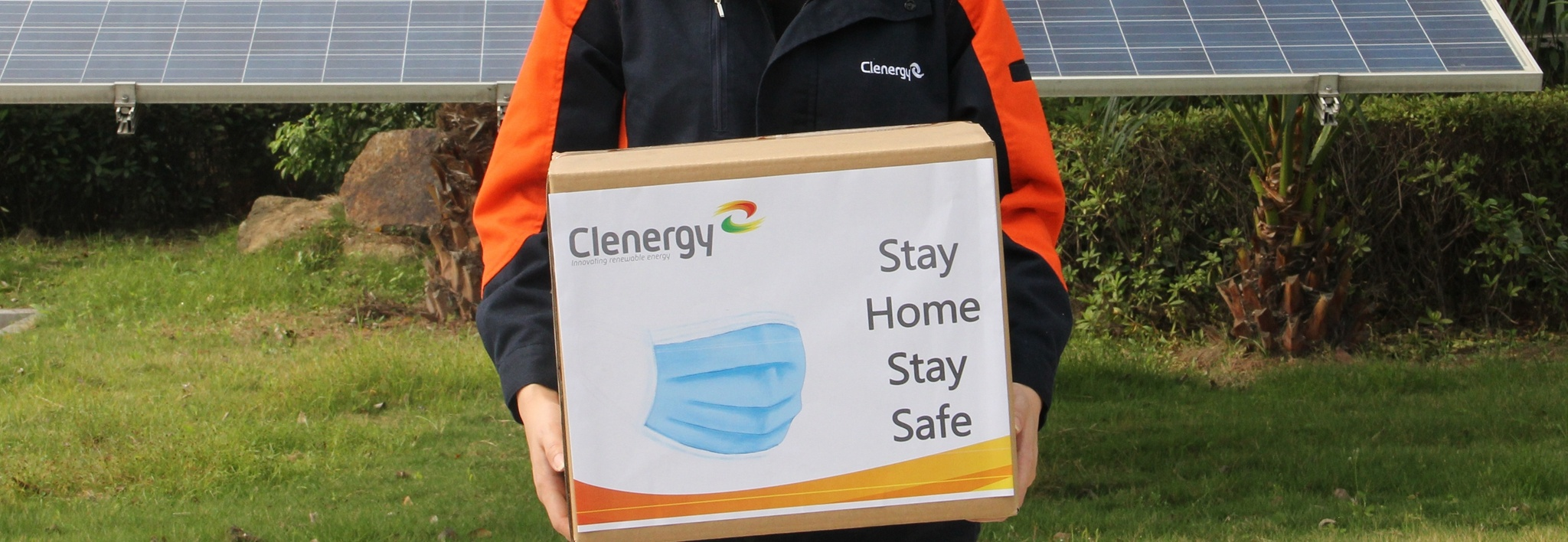 Clenergy Staff Holding a Box Full of Surgical Masks to be Donated in 2020